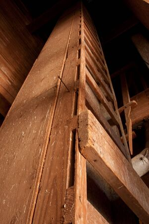 An old wooden ladder used to reach the top of a grain elevator.  The elevator can be found in Bents, Saskatchewan, Canada. photo