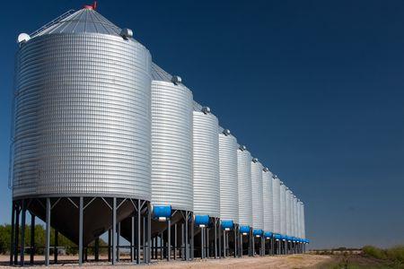 A line of steel grain bins.