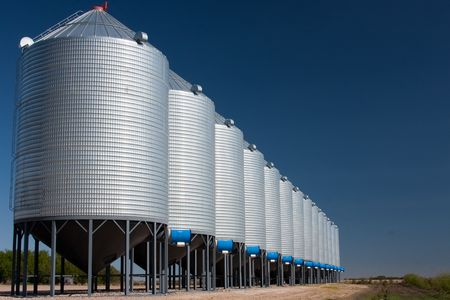 storage bin: A line of steel grain bins.