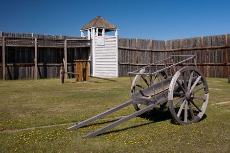 An old wooden cart at the base of Fort Carleton in central Saskatchewan of the Canadian Prairies. photo