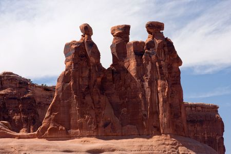 Arches National Park is a U.S. national park in eastern Utah. It is known for preserving over 2000 natural sandstone arches, including the Three Gossips formation.  The park is located near Moab, Utah. photo