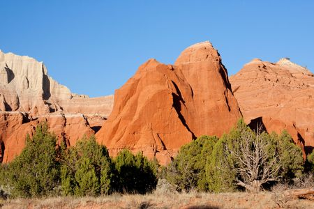 Kodachrome Basin contains many multi-colored rock formations of red, yellow, pink, white and brown, as well as massive sandstone chimney spires geologists believe to be solidified sediment that filled ancient springs or geysers left standing after the sof photo