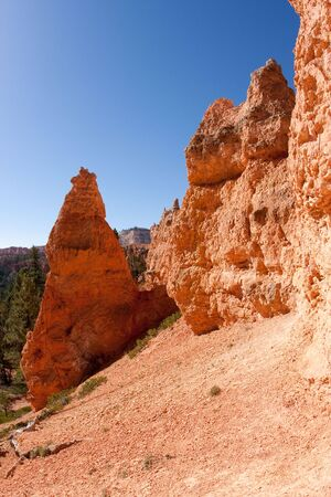 distinctive: Bryce Canyon National Park is located in southwestern Utah in the United States and is distinctive due to its geological structures, called hoodoos, formed from wind, water, and ice erosion of the river and lakebed sedimentary rocks.
