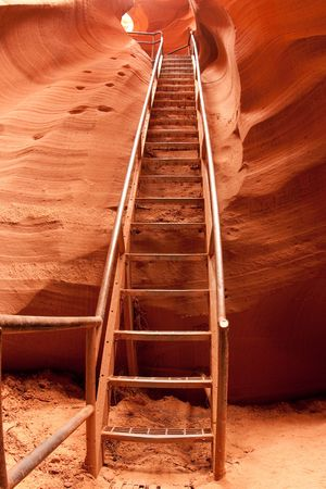 Staris help get through Antelope Canyon which is the most-visited and most photographed slot canyon in the American Southwest located on Navajo land near Page, Arizona. photo