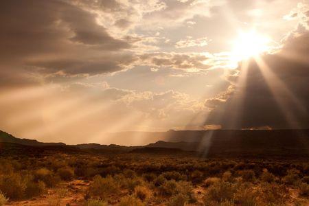 approaches: A sunset as a storm approaches along the Arizona desert.