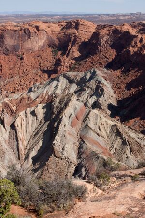 upheaval: Upheaval Dome is an impact structure, the deeply eroded remnants of an impact crater, in Canyonlands National Park near the town Moab, Utah.