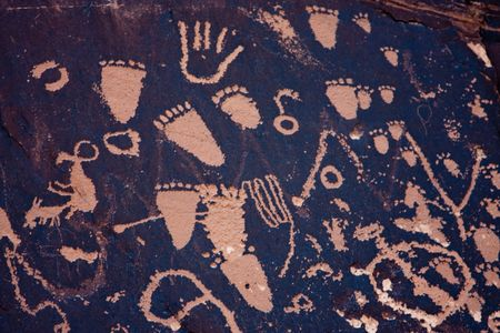 Newspaper Rock State Historic Monument features a flat rock with one of the largest known collections of petroglyphs. photo