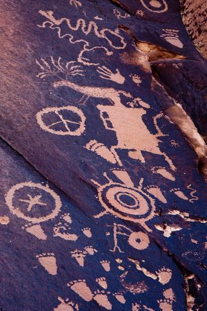 Newspaper Rock State Historic Monument features a flat rock with one of the largest known collections of petroglyphs.