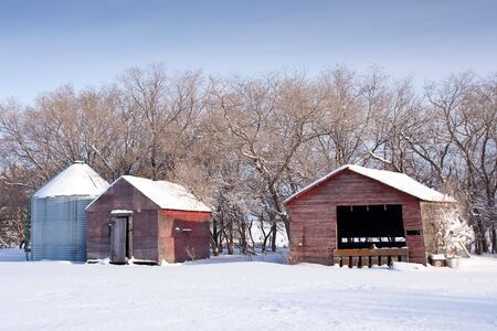 Old farm buildings in the snow of winter. Stock Photo - 6149914