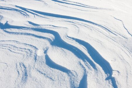 snow drift: Abstract and textures of a fresh white snow drift. Stock Photo