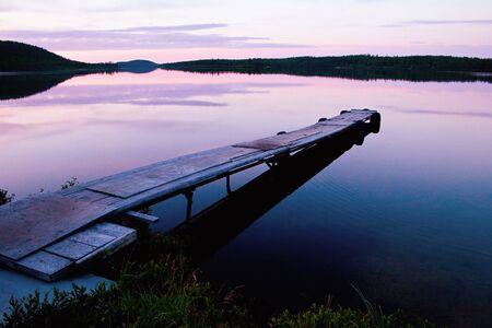 Long dock at sunset during a beautiful Canadian sunset photo