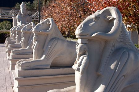 Egyptian statues in a row surrounded by fall colors. Banco de Imagens