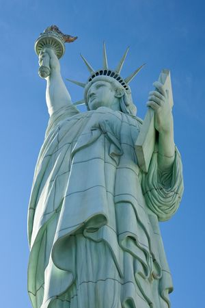 The Statue of Liberty is a monument commemorating the centennial of the signing of the United States Declaration of Independence, given to the United States by the people of France. photo