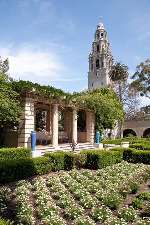 balboa: Flower garden along with the famous tower and architecture at Balboa Park in San Diego, California, USA Stock Photo