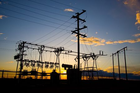 electric current: Power poles and transmission lines at sunset.