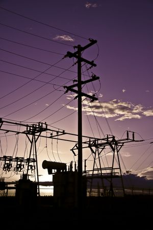Power poles and transmission lines at sunset. Stock Photo - 6715090