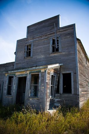 Old rustic and vintage abandoned general store in a prairie ghost town Stock Photo - 6715223