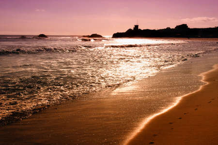 california beach: Sunset on the Pacific Ocean on the Malibu Coast of California