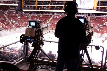 PHOENIX - APRIL 4: Cameras at NHL hockey game featuring the Phoenix Coyotes and Edmonton Oilers of the National Hockey League. April 4, 2010 in Phoenix, Arizona.