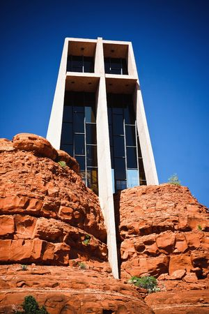 The Chapel of the Holy Cross is an iconic Catholic chapel built into the mesas of Sedona, Arizona.  It is built directly into a butte and offers a spectacular view of the valley below. Stock Photo - 7035901