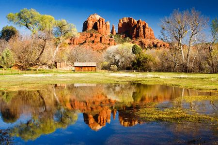 The view of Cathedral Rock in Sedona, Arizona.  The towering rock formations stand out like beacons in the dimmed landscape of the Red Rock State Park. photo