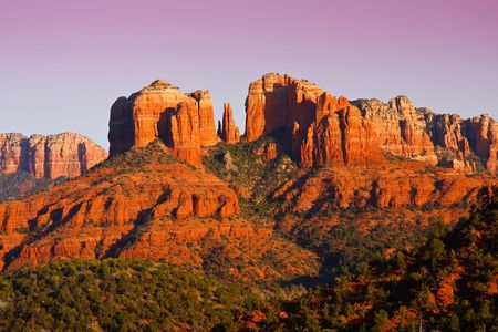 sedona: The view of Cathedral Rock in Sedona, Arizona.  The towering rock formations stand out like beacons in the dimmed landscape of the Red Rock State Park.