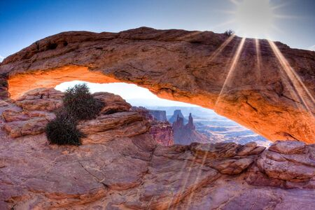 mesa: Mesa Arch in Canyonlands National Park, Utah at sunrise when the underside of the arch glows dramatically red and orange.