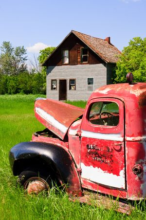 Old rusty red farm truck fading in time. Stock Photo - 7581833