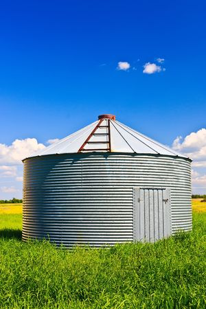 Metal grain silo used to store grain and other farm crops. photo
