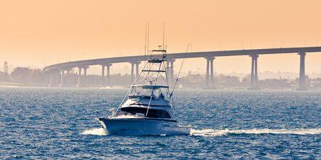 referred: San Diego - Coronado Bridge, locally referred to as the Coronado Bridge, is a concrete & steel girder bridge, crossing over San Diego Bay in the United States, linking San Diego, with Coronado, California.