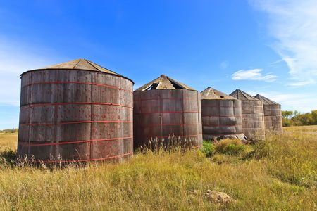Old wood grain storage bins on the prairies Stock Photo - 7904792