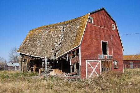 Old abandoned red barn on the prairies of Canada. photo