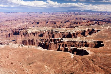 mesas: Canyonlands National Park is located near the city of Moab, Utah and preserves a colorful landscape eroded into countless canyons, mesas and buttes by the Colorado River, the Green River, and their respective tributaries.