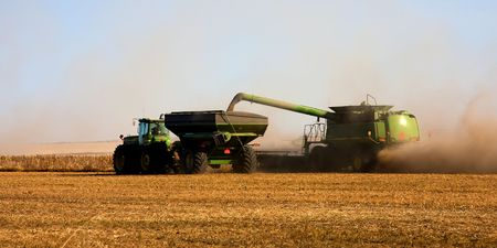 Combine and tractor working on the fall harvest. photo