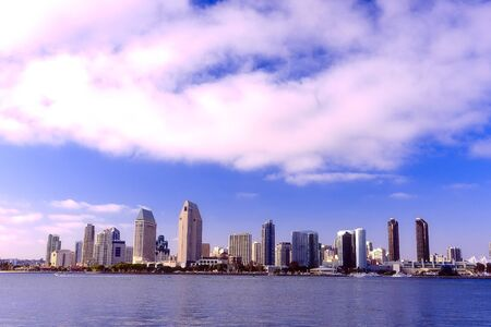diego: San Diego city skyline at sunset, showing the buildings of downtown rising above harbor viewed from Coronado Island.