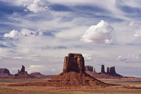 Monument Valley is a Navajo Nation tribal park which has some of the most striking and recognizable landscapes of sandstone buttes, mesas and spires in the entire American Southwest. Stock Photo
