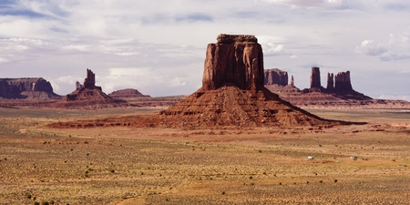 definitive:    Monument Valley provides perhaps the most enduring and definitive images of the American West. The isolated red mesas and buttes surrounded by empty, sandy desert have been filmed and photographed countless times  Stock Photo