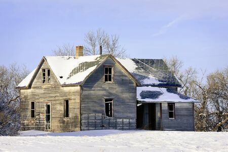Old abandoned farm house in a frosty winter wonderland