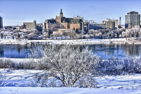 Hoarfrost covers the trees on a cold winter day in Saskatoon, Canada photo