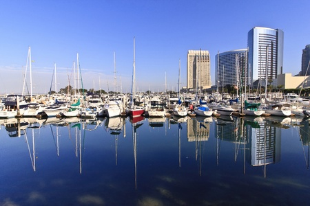 San Diego city skyline showing the buildings of downtown rising above harbor where the many boats sit. Stok Fotoğraf