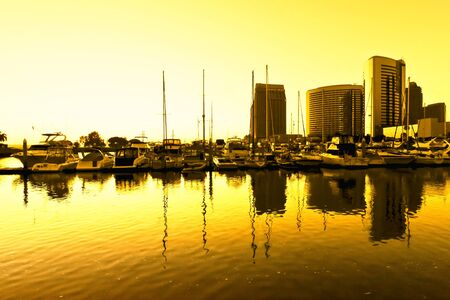 Sun setting on the pier and buildings in San Diego
