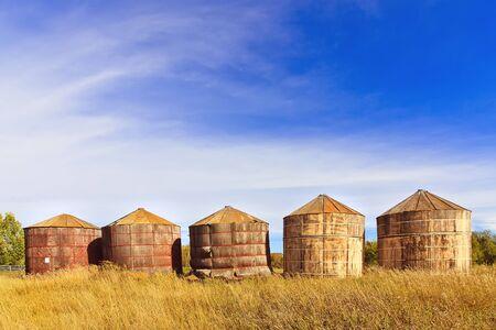 Old wood grain storage bins on the prairies