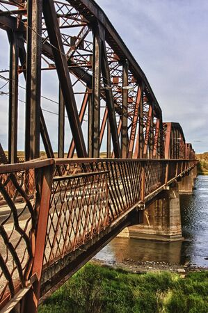 metal structure: Old rustic steel bridge over the North Saskatchewan River near the town of St.Louis