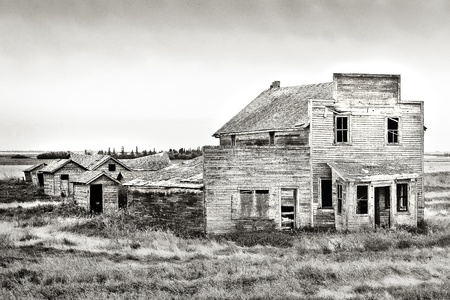Old rustic and vintage abandoned general store in the Canadian prairie ghost town of Bents photo