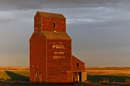Old abandoned grain elevator at sunset in the ghost town of Bents in central Saskatchewan, Canada photo