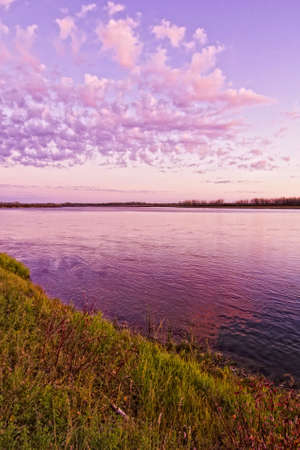 Sunset with pink clouds against the blue sky over the calm waters Stock Photo - 9454155