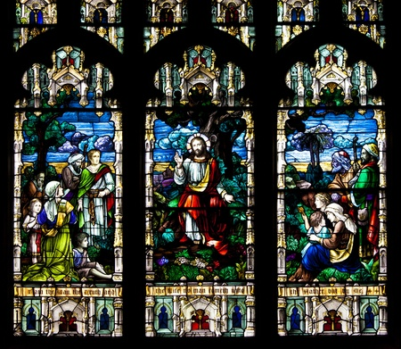 Stained glass windows at church reflecting religious figures Editoriali