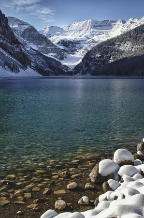 settles: Winter settles on Lake Louise, Alberta in the Canadian Rockies