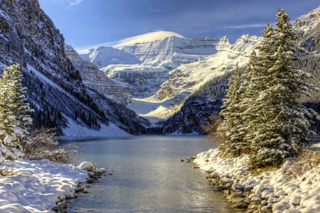 Early winter snow settles on Lake Louise, Alberta in the Canadian Rockies