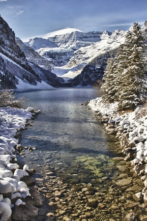 frozen lake: River leading into Lake Louise, Alberta in the Canadian Rockies Stock Photo
